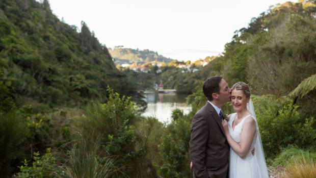 The couple shares a quiet moment overlooking the old reservoir at Zealandia.