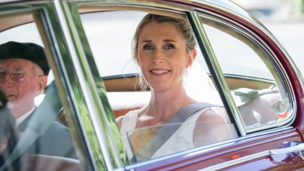The bride arrives in a 1967 Jag, owned (and driven) by one of her father's friends.