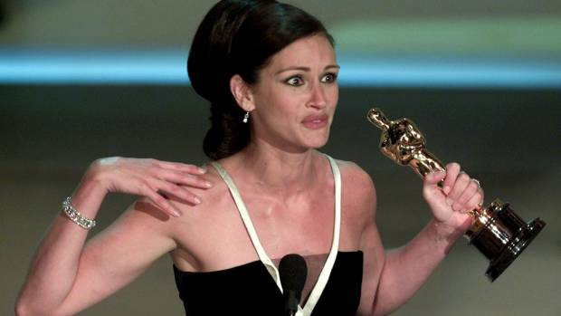"""Julia Roberts accepts her Oscar for Best Actress for her role in """"Erin Brockovich""""."""
