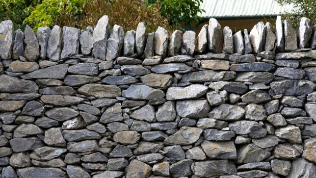 In Robert Frost's 1914 poem 'Mending Wall' two men repair a stone boundary wall together every spring. One neighbour ...