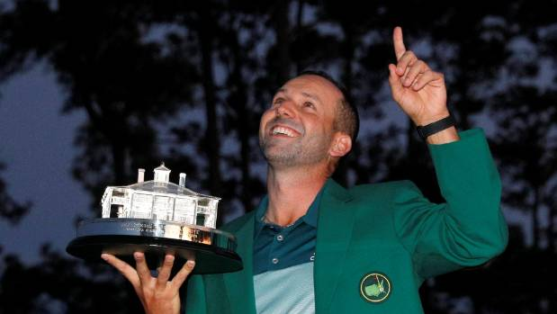 Green jacket on, and trophy in hand, Sergio Garcia celebrates his breakthrough Masters Tournament victory.