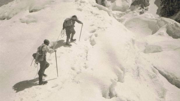 Two climbers from the 1951 NZ Himalaya expedition ascend Mukut Parbat, a significant peak.