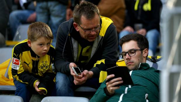 Borussia Dortmund fans waiting for the Champions League quarterfinal against Monaco check for news of the explosions.