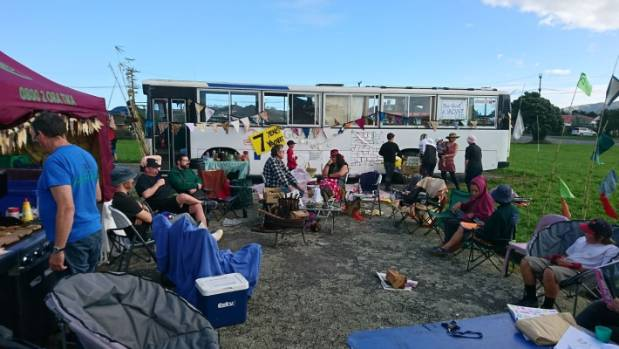 People camped out  to demand homes be built on Housing New Zealand land that has stood empty for 8 years.