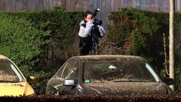 A police forensics expert photographs the scene of the explosion at the Dortmund hotel.