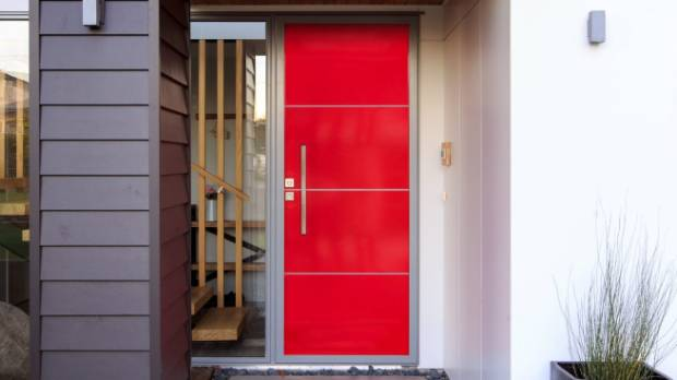 The striking contrast between the grey exterior and the  red door makes this house a stand-out. You could give your home ...