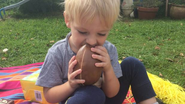Why you should let your kids eat all the chocolate at easter charlie three tucks into a chocolate egg one of many treats he will negle Choice Image