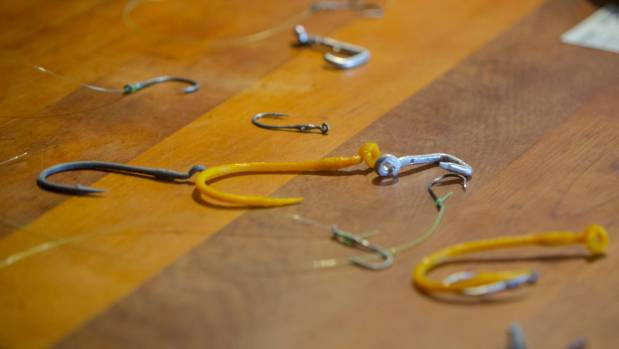 Tran Lawrence designed a selection of fish hooks to use without the need to tie a knot to the line.