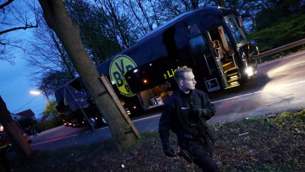 Police with the Borussia Dortmund team bus where a bomb was placed to go off as they travelled to their Champions League ...