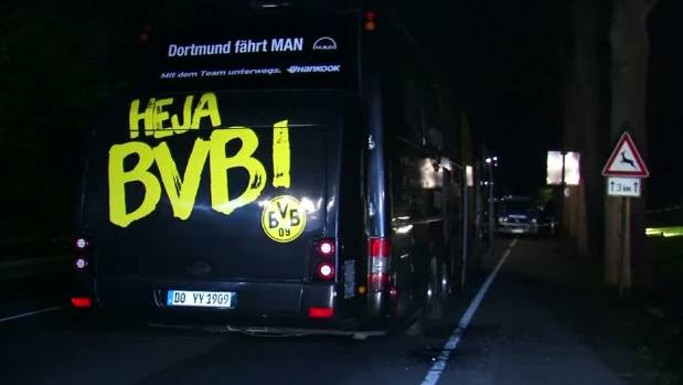 German police search the area where the bus carrying Borussia Dortmund to their Champions League quarterfinal match ...