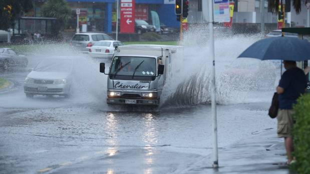 Heavy rainfall across Auckland flooded roads, including major arterial route St Lukes Road on Wednesday.