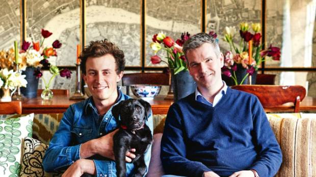 Charlie McCormick and Ben Pentreath with Mavis the five-month-old black Labrador puppy in their sitting room.