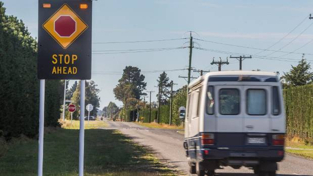 One of Dan Harker's solar-powered stop-sign warning sign, on Maddisons Rd at the intersection with Weedons Ross Rd.