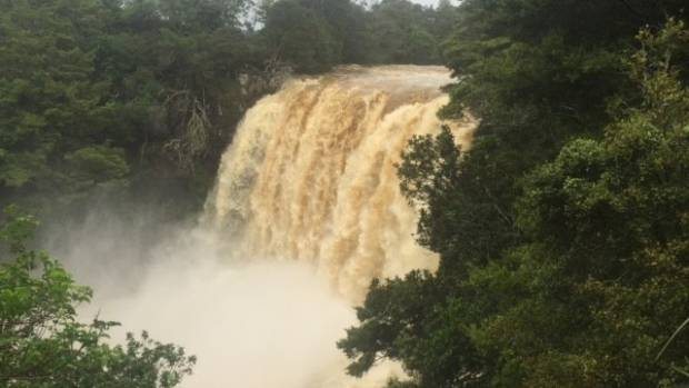 Kerikeri's Rainbow Falls is gushing with muddy water after heavy rain.