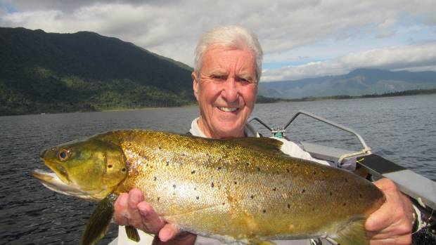 Phil Clark of Australia with one of the residents of lake Ianthe, South Westland.