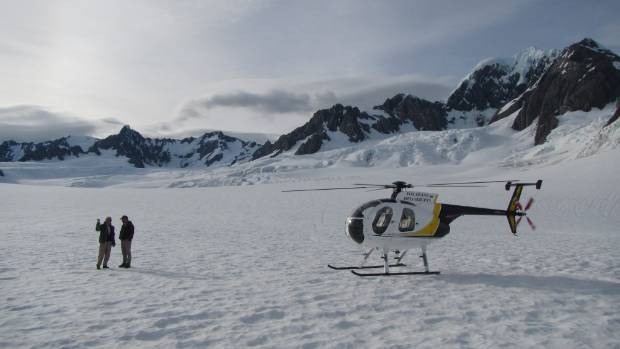 Helicopter landing at Fox Glacier