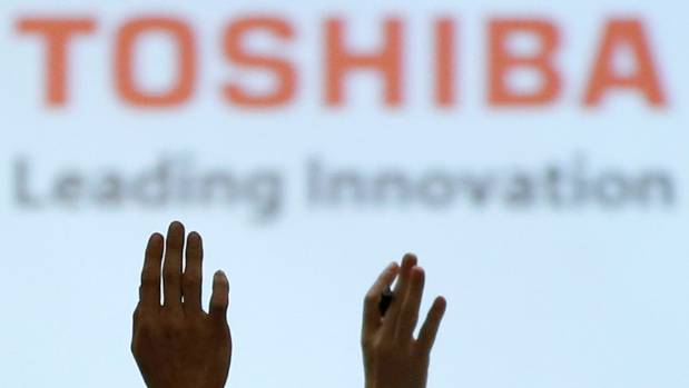 Toshiba signs $18B deal to sellchip unit to Bain