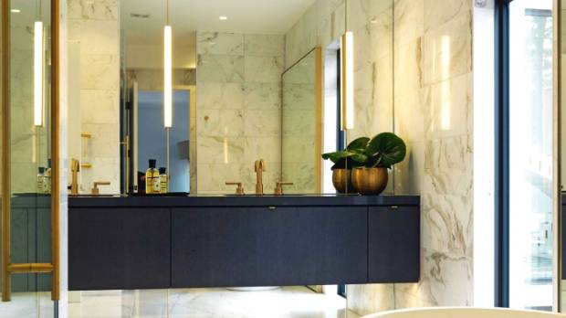Brass touches bring a luxury feel to this high-end bathroom.