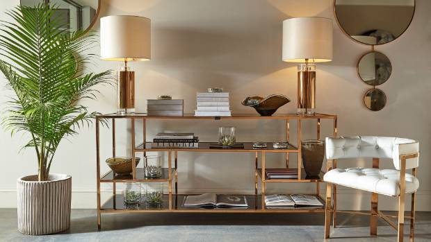 The brass finish of Kelly Hoppen's Miro Etagere unit has a 70s glamour feel, and is available from Frobisher Interiors ...