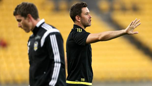 Wellington Phoenix co-coach Des Buckingham, right, speaks to the players during a game this season.