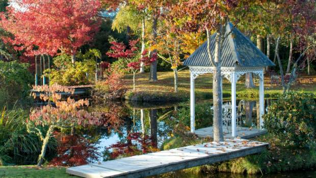 This gazebo and other whimsical structures give the garden character, says Michael.