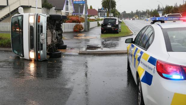 Hamilton police say no one was injured when this van skidded onto its side in heavy rain in Hamilton on Thursday afternoon.