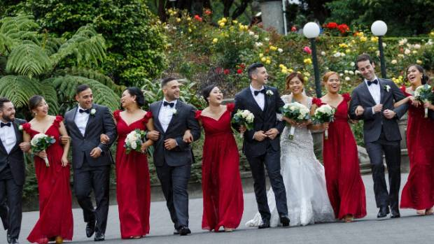 The bridal party in red, white and black.