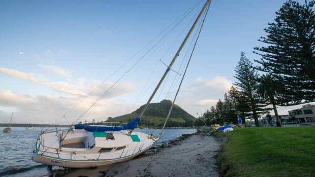 A yacht thrust ashore by Cyclone Cook in the night at Pilot Bay in Mount Maunganui, Tauranga.