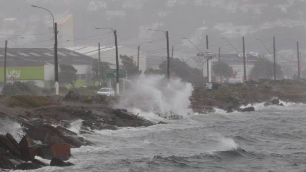 Waves crashing over Cobham Drive in Wellington on Friday morning. Cyclone Cook passed over Wellington about 2am on Friday.