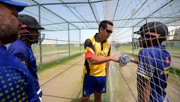 Ross Taylor lends a hand to the Papua New Guinea batsmen.