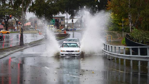 The Avon river encroaches onto Fitzgerald Ave near Kilmore intersection in Christchurch.