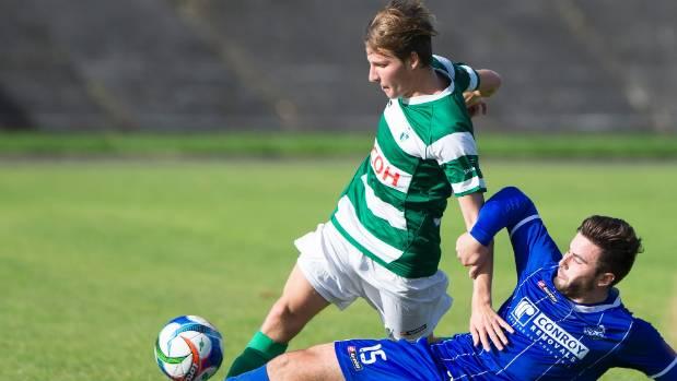 Palmerston North Marist midfielder Luke Palfreyman, left, evades the sliding tackle of Napier City Rovers defender Jim ...