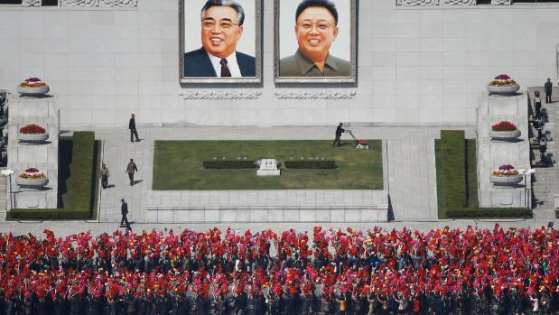 People practice for the expected parade on the main Kim Il-Sung Square in central Pyongyang.