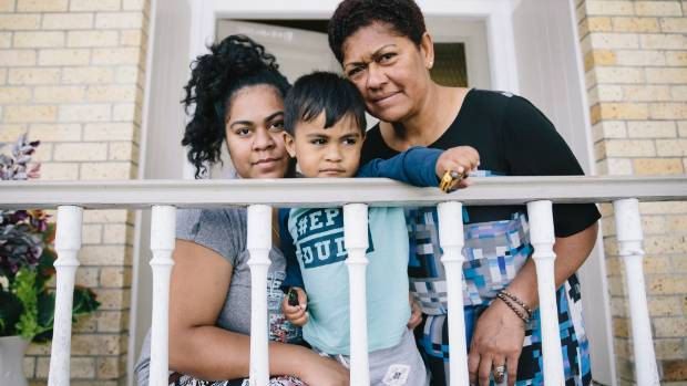 Alfreda Chong comforts her son, Matthew Chong, 2, and mother Vula Hughes at the family home in Melville.