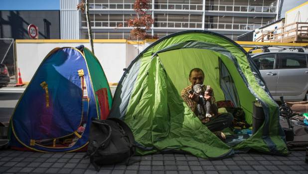 Abraham Neho has been keeping dry in a tent on Colombo St, Christchurch.