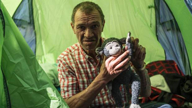 Neho, with his teddy, has few possessions, with just blankets and bedding in the tent.