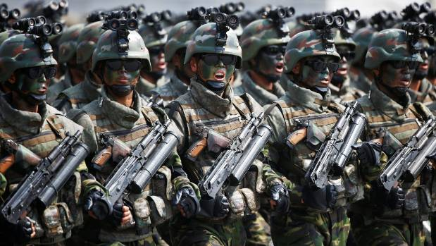 North Korean soldiers march and shout slogans during a military parade marking the 105th birth anniversary of country's ...