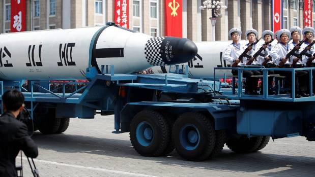 Military vehicles carry missiles with characters reading 'Pukkuksong' during a military parade marking the 105th birth ...