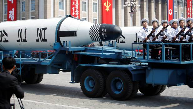 "Military vehicles carry missiles with characters reading ""Pukkuksong"" during the military parade in North Korean marking ..."