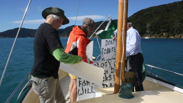Green MP Steffan Browning, left, prepares signs for the protest.