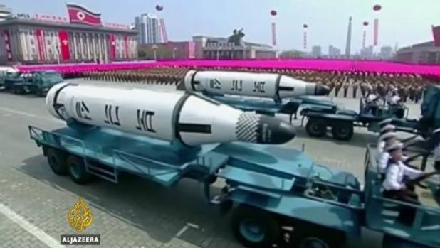 North Korea showcases new missiles at a weekend military parade.