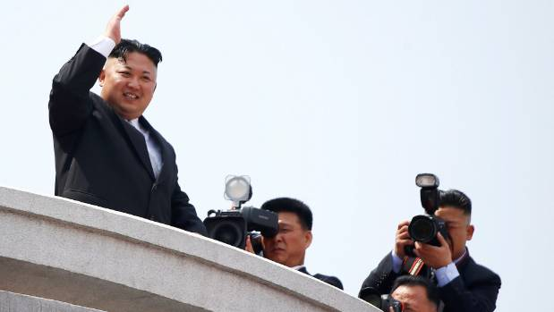 North Korean leader Kim Jong Un waves to people attending the military parade on Saturday.