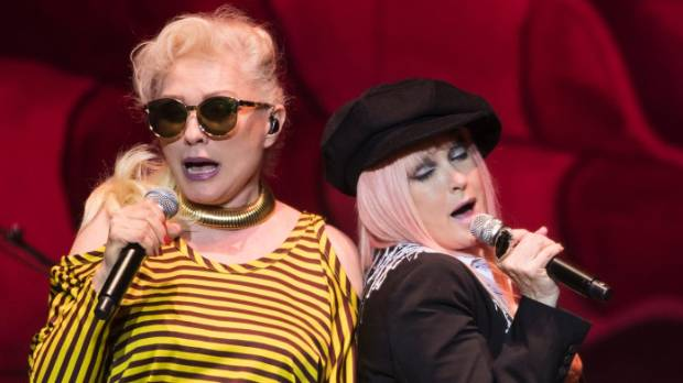 Debbie Harry, left, sings as a guest during Cyndi Lauper's set during the Blondie/Cyndi Lauper concert at Horncastle Arena.