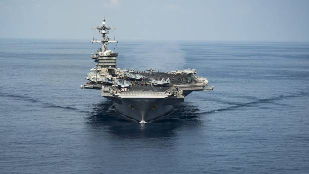 The aircraft carrier USS Carl Vinson led a US fleet back to the east coast of the Korean Peninsula as tensions with ...