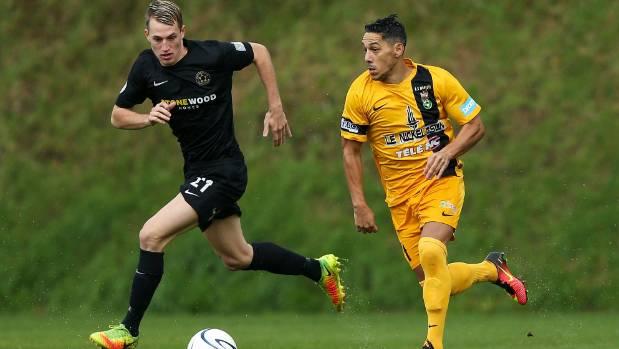 AS Magenta's Nicolas Marin is put under pressure by Team Wellington's Niko Kirwan on Sunday.