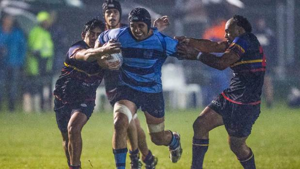 Central player Reyne Volavola tries to break through the Harlequins defense during their game at a soaked Lansdowne Park ...
