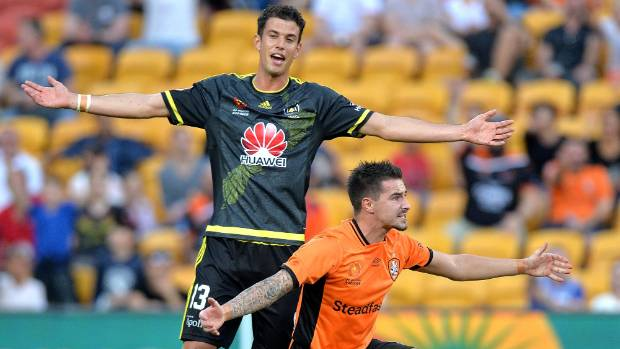 Wellington Phoenix defender Marco Rossi, left, and Brisbane Roar striker Jamie Maclaren both appeal to the referee on ...