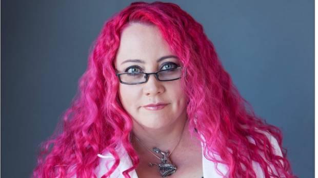 Dr Siouxsie Wiles has had pink hair her entire working life. It has nothing to do with her ability to do her job.