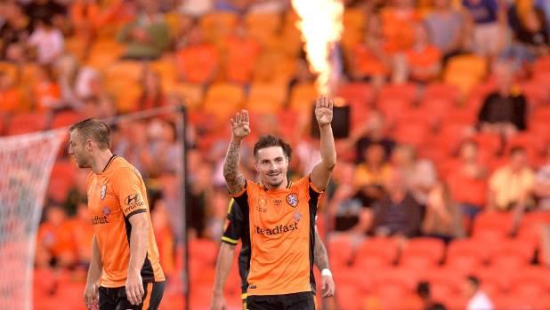 Brisbane Roar striker Jamie Maclaren celebrates scoring a goal against the Wellington Phoenix on Sunday night.