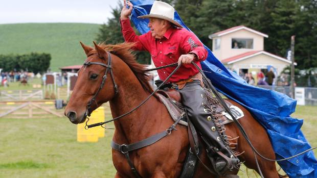 Veteren cowboy Jim Rush on Strolla competes in the tarp drag in the cowboy challenge at the 119th Mackenzie Highland A&P ...